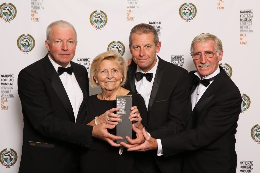 Esme Allchurch receives Ivor Allchurch's award at the National Football Museum Hall of Fame Award Evening 2015 pictured with sons David and John and award presenter Cliff Jones. Picture: Jason Lock