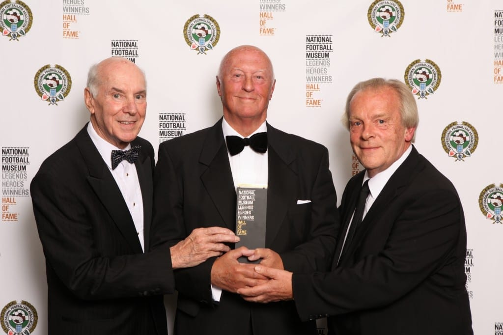 Pictured centre Bob Crompton with the award for the late Bob Crompton which was collected by his family members with Gordon Taylor and Keith Lee, President of Blackburn Rovers at the National Football Museum Hall of Fame Award Evening 2015 Picture: Jason Lock