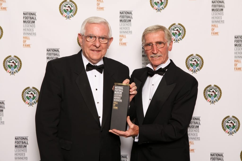 Alan Mullery collecting his award from Cliff Jones at the National Football Museum Hall of Fame Award Evening 2015 Picture: Jason Lock