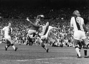 Crystal Palace v Manchester United, March 1974.  Denis Law blasts the ball into the back of the net. Pic courtesy of Mirrorpix.
