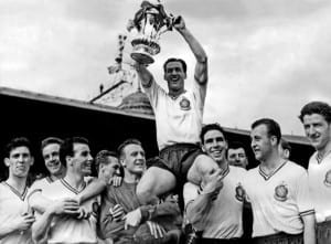 Bolton Wanderers Beat Manchester United at Wembley: Bolton players chair their Captain and hero Nat Lofthouse with the cup, at the end of the match. May 1958. Pic courtesy of Mirrorpix.