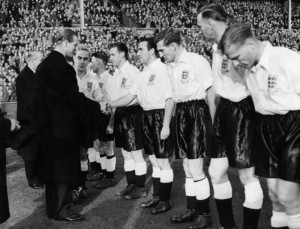 Home International match at Wembley Stadium. England 5 v Wales 2.  England player Alf Ramsey shakes hands with Prince Philip, the Duke of Edinburgh, before the match. 12th November 1952. Image courtesy of Mirrorpix.