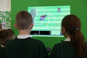 Pitch to Pixel: The World of Football Gaming – School pupils playing Nintendo World Cup Picture © Jason Lock