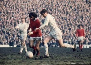 FA Cup Semi Final match  Leeds United 0 v Manchester United 0 George Best is challenged for the ball by Norman Hunter  14th March 1970. Image courtesy of Mirrorpix