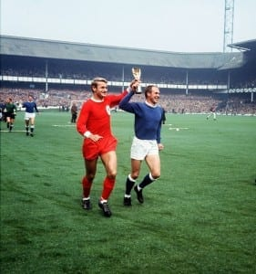 Roger Hunt football player for Liverpool and Ray Wilson of Everton run around Goodison Park displaying the Jules Rimet World Cup 1966. Pic courtesy of Mirrorpix.