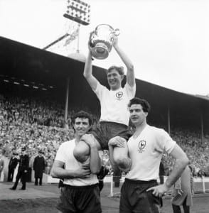 FA Cup final at Wembley Stadium. Tottenham Hotspur 3 v. Burnley 1.  Spurs captain Danny Blanchflower sits on the shoulders of teammates Bobby Smith and Maurice Norman  as he holds aloft the trophy, May 1962. Pic courtesy of Mirrorpix.