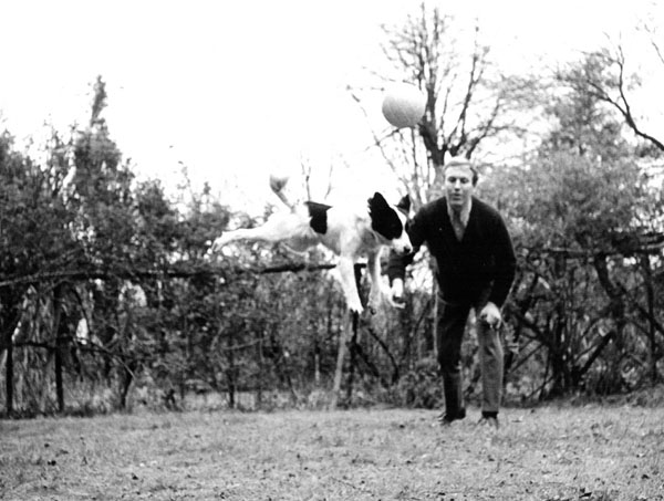 Pickles and David Corbett play football in the garden, 1966.