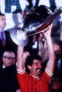 Liverpool captain Graeme Souness holds aloft the European Cup trophy after their victory over AS Roma in the Final in Rome. May 1984. Pic via Mirrorpix.
