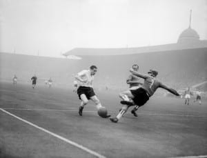 Stan Mortensen scoring a goal for England in the first ever match against a  Rest of the World team  October 1953. Pic via Mirrorpix.