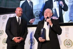 Alan Shearer presents a Hall Of Fame trophy to Hughie Gallacher's son, Matty. National Football Museum, 2014.