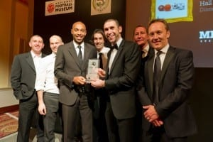 Thierry Henry receives his National Football Museum Hall Of Fame award from Arsenal team-mates Nigel Winterburn, Freddie Ljungberg, Robert Pires, Martin Keown, Ray Parlour and Lee Dixon.