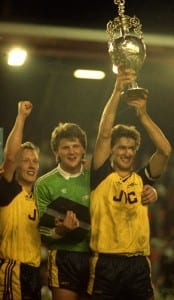 English League Division One match at Anfield Liverpool 0 v Arsenal 2 Arsenal players Lee Dixon, goalkeeper John Lukic and Tony Adams celebrate their dramatic Championship clinching victory at Anfield, following the 91st minute by Michael Thomas May 1989. Pic by Mirrorpix.