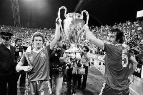 European Cup Final at the Olympic Stadium in Munich.  Nottingham Forest 1 v Malmo 0. Forest players Tony Woodcock (left) and Larry Lloyd celebrate with the trophy after the match.  30th May 1979. Pic via Mirrorpix.