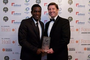 Former Port Vale and Wimbledon midfielder Robbie Earle is presented with his Community Champion award by the Football Foundation's Paul Thorogood.