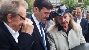 Denis Law, Andy Burnham and Paul Trevillion admire the Walk of Fame plaque.
