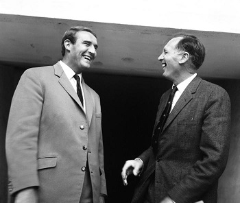 Joe Mercer manager of Manchester City shares a joke with his new assistant manager Malcolm Allison. 22nd July 1965