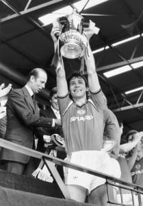 Bryan Robson, Manchester United's captain, shows off the FA cup to the Wembley crowd after victory over Everton at Wembley stadium. Pic courtesy of Mirrorpix.