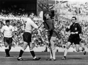 Dave Mackay of Tottenham Hotspur confronts Billy Bremner of Leeds during their  First Division Football match at White Hart Lane. 29th August 1966. Pic via Mirrorpix.