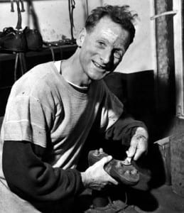 Preston North End prepare for cup battle with Brighton. Tom Finney, Preston's ace, who has put many a spanner in opposition works during his brilliant career, tightens up the screw - in studs of his boots before taking part in a full scale practice match. January 1960 P012596. Pic via Mirrorpix