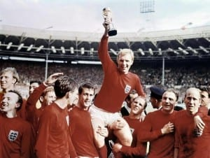1966 World Cup Final at Wembley Stadium July 1966 England 4 v West Germany 2  Captain Bobby Moore holds aloft the original Jules Rimet trophy as he sits on the shoulders of his teammates. Pic by Mirrorpix