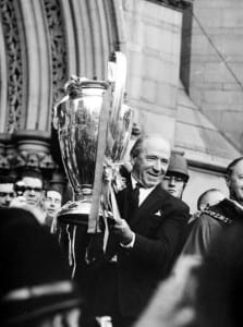 Manchester United Football Team return after winning the European Cup - Matt Busby holds the cup high outside Manchester town hall June 1968. Pic via Mirrorpix.
