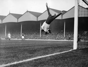 Manchester City goalkeeper Frank Swift making an athletic save in a league match against Arsenal at Highbury October 1934. Pic courtesy of Mirrorpix.