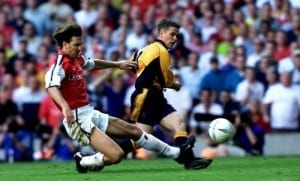 FA Cup Final at Millennium Stadium, Cardiff. Liverpool 2 v Arsenal 1. Michael Owen scores the winning goal, late in the match past the sliding challenge of Tony Adams. 12th May 2001. Pic courtesy of Mirrorpix.