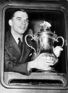 Sunderland captain Raich Carter with the FA Cup trophy on his way back to Sunderland by train after his team had beaten Preston in the 1937 FA Cup Final  May 1937. Pic courtesy of Mirrorpix