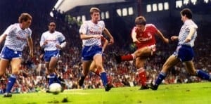 Peter Beardsley scores for Liverpool against Manchester United at Anfield. September 1990. Pic courtesy of Mirrorpix.
