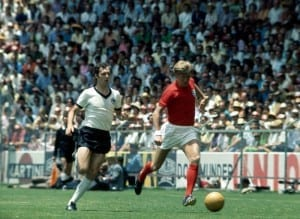 World Cup Quarter Final match in Leon, Mexico England 2 v West Germany 3 after extra time England's Colin Bell on the ball chased by Franz Beckenbauer  June 1970. Pic courtesy of Mirrorpix.