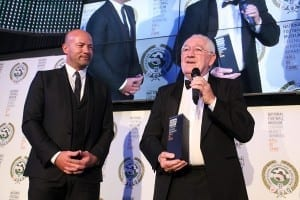 National Football Museum Hall of Fame 2014.  Matthew Gallacher accepts the Hall Of Fame award on behalf of his late father, Hughie, watched by Alan Shearer. Picture: Karin Albinsson