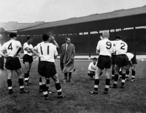 England Under 23 team trial game against an England eleven at Old Trafford, Manchester, prior to Under 23's match against a Danish eleven. England team manager Walter Winterbottom chats over positional moves with the England team players during the game's interval. The game provided good practice for the England team, too, - they play against Ireland in October. September 1960 P008137. Picture courtesy of Mirrorpix.