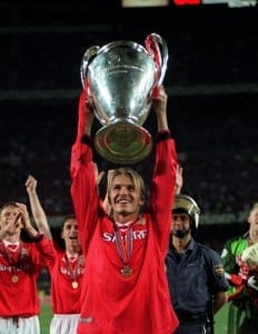 Manchester United player David Beckham May 1999 with  the Champions League Cup trophy after his team beat Bayern Munich 2-1 to win the UEFA Champions Cup final at the Nou Camp Stadium in Barcelona. Pic via Mirrorpix.