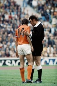 1974 World Cup Final at the Olympic Stadium, Munich. West Germany 2 v Holland 1. British referee Jack Taylor has a quiet word with Dutch star Johan Cruyff. 7th July 1974. Pic by Mirrorpix.