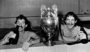 Champagne and a bath for Graeme Souness and Terry McDermott of Liverpool after today's championship triumph.  May 1980. Pic via Mirrorpix.