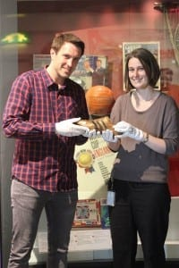 Dr Martin Gebhardt of Adidas hands over Geoff Hurst's boot to Wiebke Cullen of the National Football Museum.