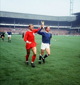 Roger Hunt football player for Liverpool and Ray Wilson of Everton run around Goodison Park displaying the Jules Rimet World Cup 1966. Pic by Mirrorpix.