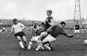 Burnley v. Liverpool: Liverpool's first goal scored by Roger Hunt, left as he drives the ball past Las Latcham, Colin Waldron and Burnley goalkeeper, Harry Thomson. October 1968. Pic via Mirrorpix.