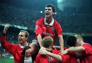 Roy Keane Manchester United midfielder March 1999 celebrates with teammates after striker Paul Scholes scored against Inter Milan during Champions League second leg quarter final at the San Siro stadium. Pic via Mirrorpix