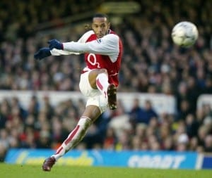 Football Arsenal v Middlesbrough January 2004 Carling Cup Semi-final 1st leg at Highbury Thierry Henry strikes the ball goalwards for the second goal. 20th January 2004. Pic via Mirrorpix