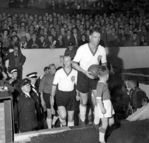 Billy Liddell leads out the stars for his testimonial match at Anfield, Liverpool with Tom Finney and Bert Trautmann following on.  September 1960 Pic by Mirrorpix.