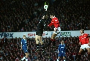 Everton goalkeeper Neville Southall catches the ball with Eric Cantona jumping Manchester United v Everton 23rd January 1994. Pic courtesy of Mirrorpix.