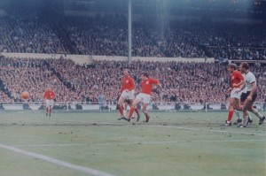 1966 World Cup Final at Wembley Stadium. England 4 v West German2 after extra time. Martin Peters scores his side's second goal as Jack Charlton looks on.  30th July 1966. Pic via Mirrorpix.