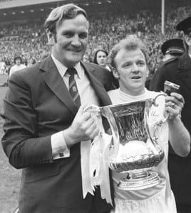 Leeds United legend Don Revie holding the FA Cup with Whites captain Billy Bremner after their 1972 triumph over Arsenal. Image via Mirrorpix.