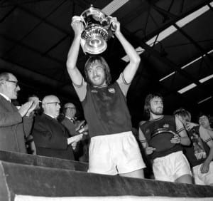 Billy Bonds lifts the 1975 FA Cup at Wembley after the Hammers' 2-0 victory over Fulham. (Image via Mirrorpix)