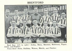The Brentford FC team in red and white stripes in