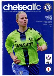 A football programme with a Chelsea Ladies football player on the cover
